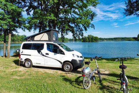 Nissan NV200 CamperCar Sussex Campervans lake with bikes.JPEG