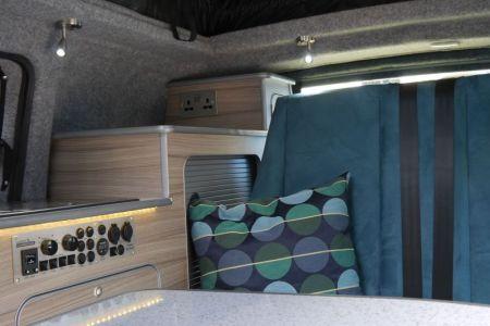 Nissan NV200 CamperCar Sussex Campervans pedestal table bespoke upholstery.JPG
