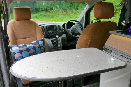 Nissan NV200 CamperCar Sussex Campervans front swivel dining cafe ecosuede seats.JPG